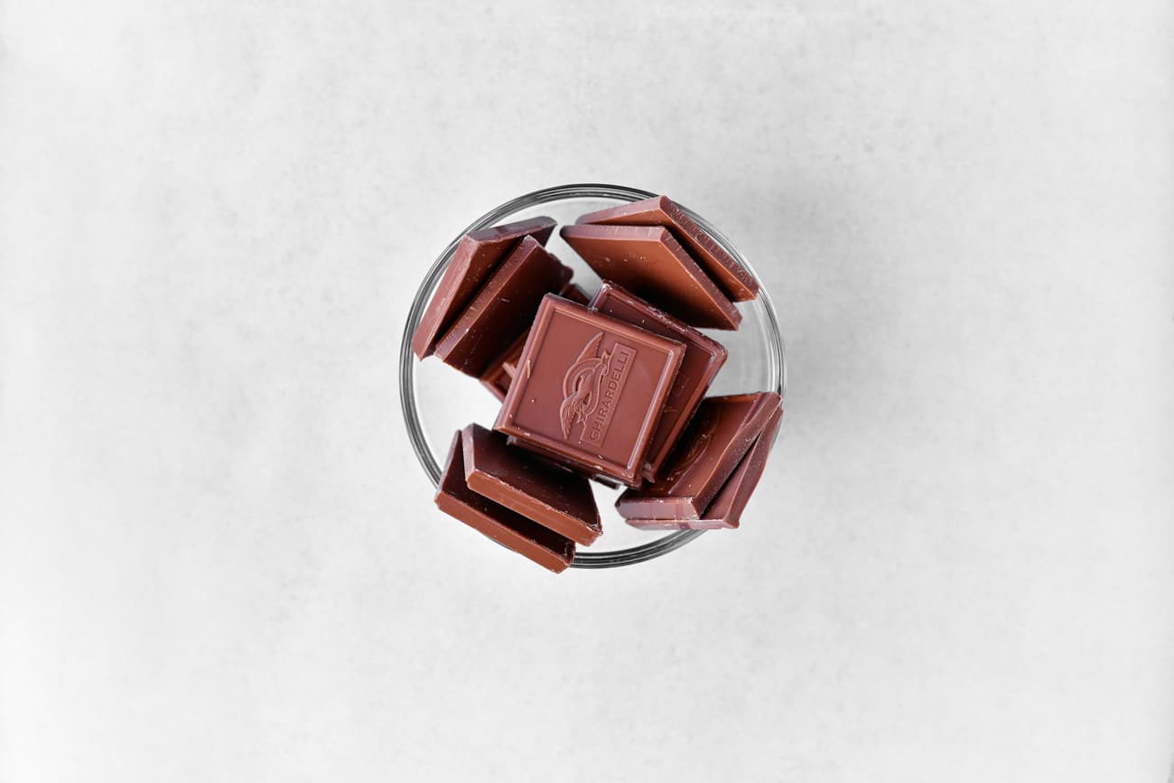 milk chocolate squares in a clear glass bowl
