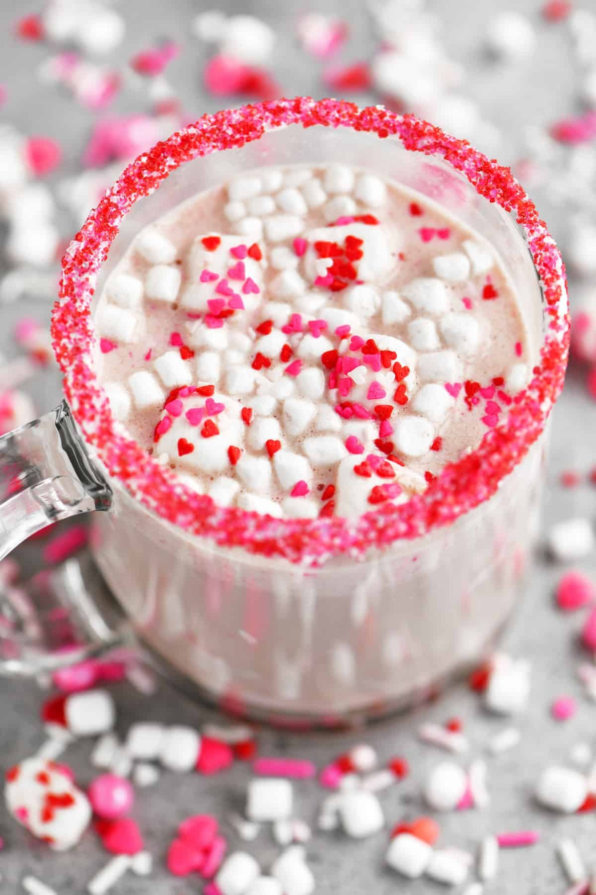 marshmallows and heart shaped sprinkles in a cup of hot chocolate