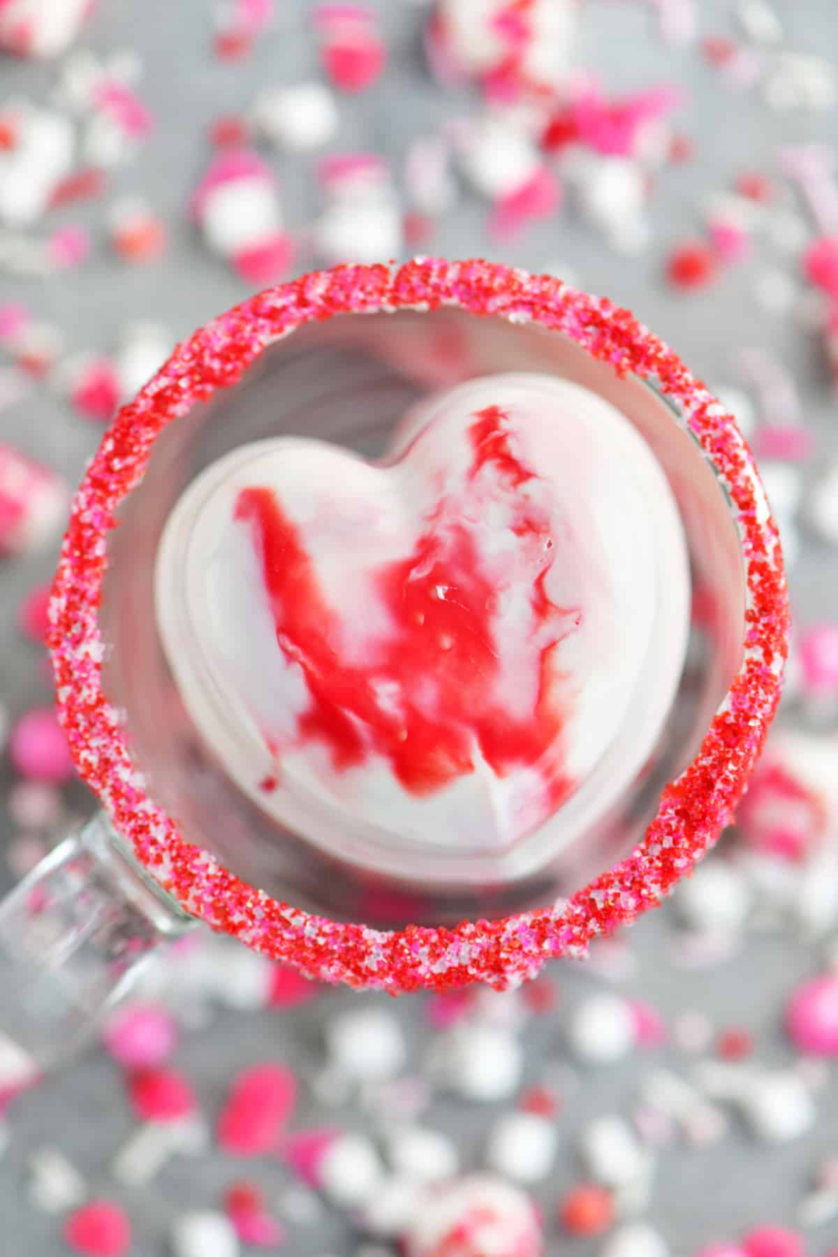 a heart shaped hot chocolate bomb in a cup of hot chocolate