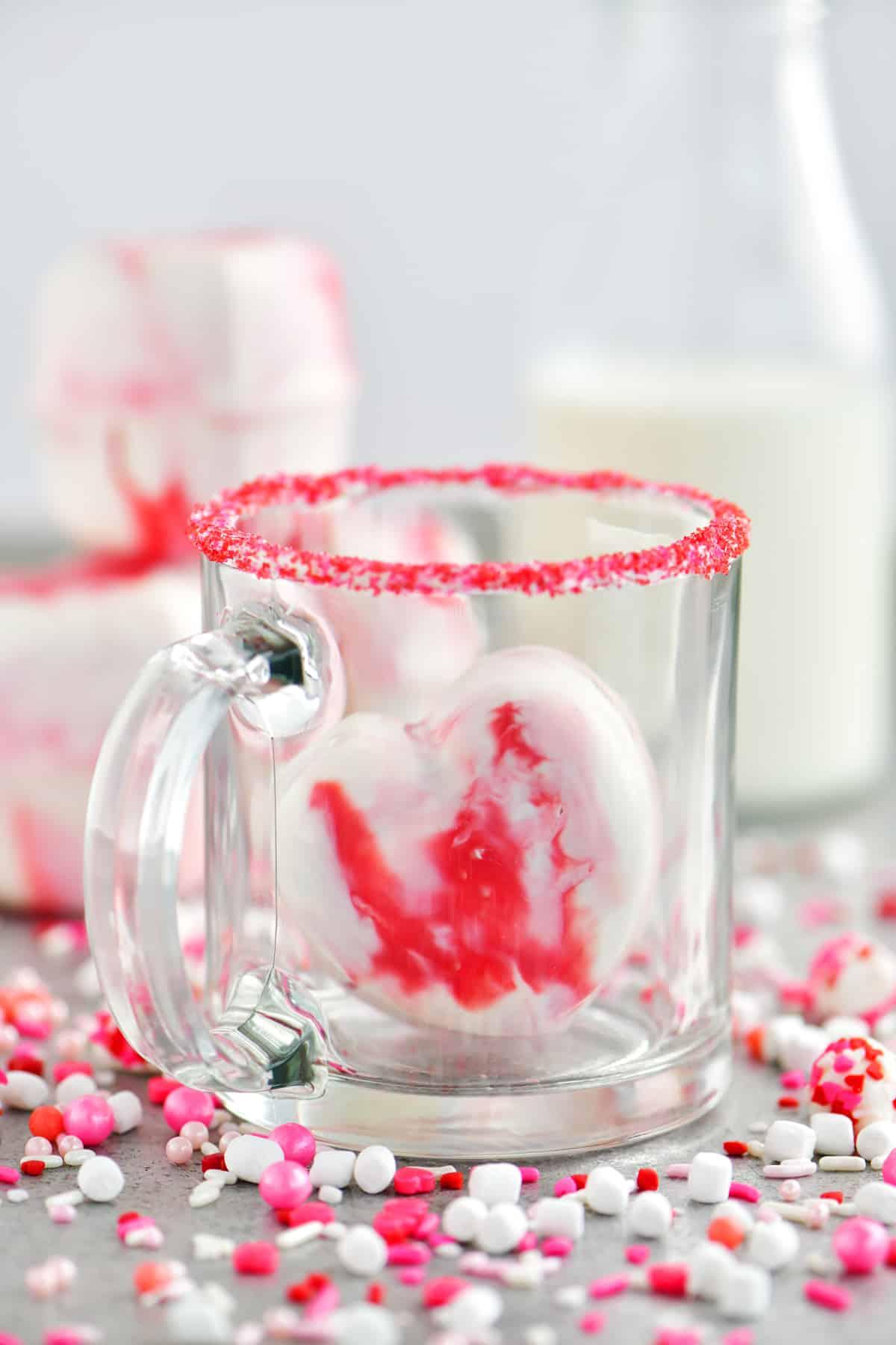 heart shaped hot chocolate bomb in a mug