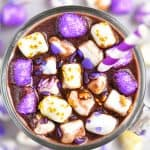 mug of hot chocolate with purple sprinkles on marshmallows