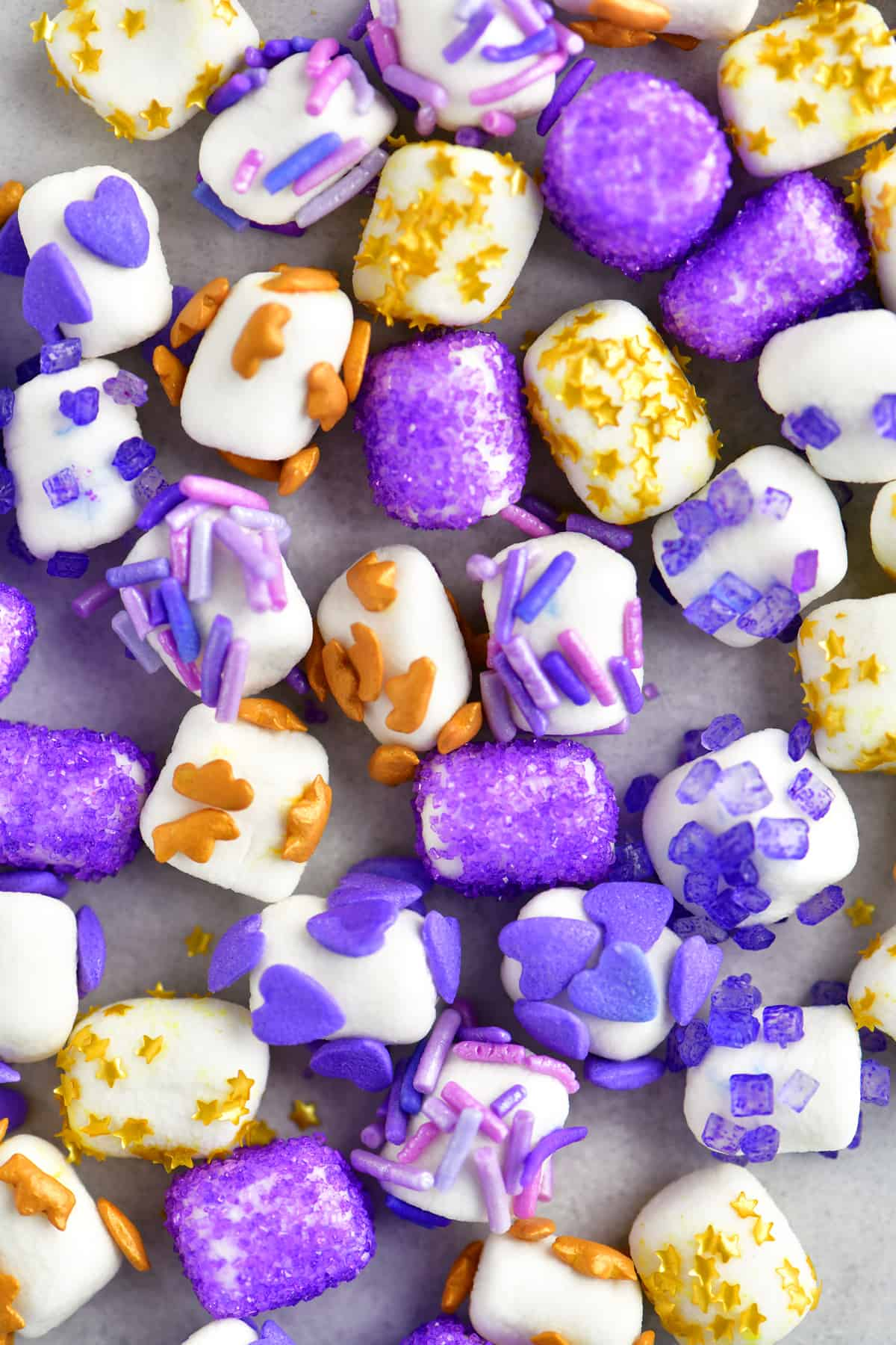 purple and gold sprinkles on mini marshmallows