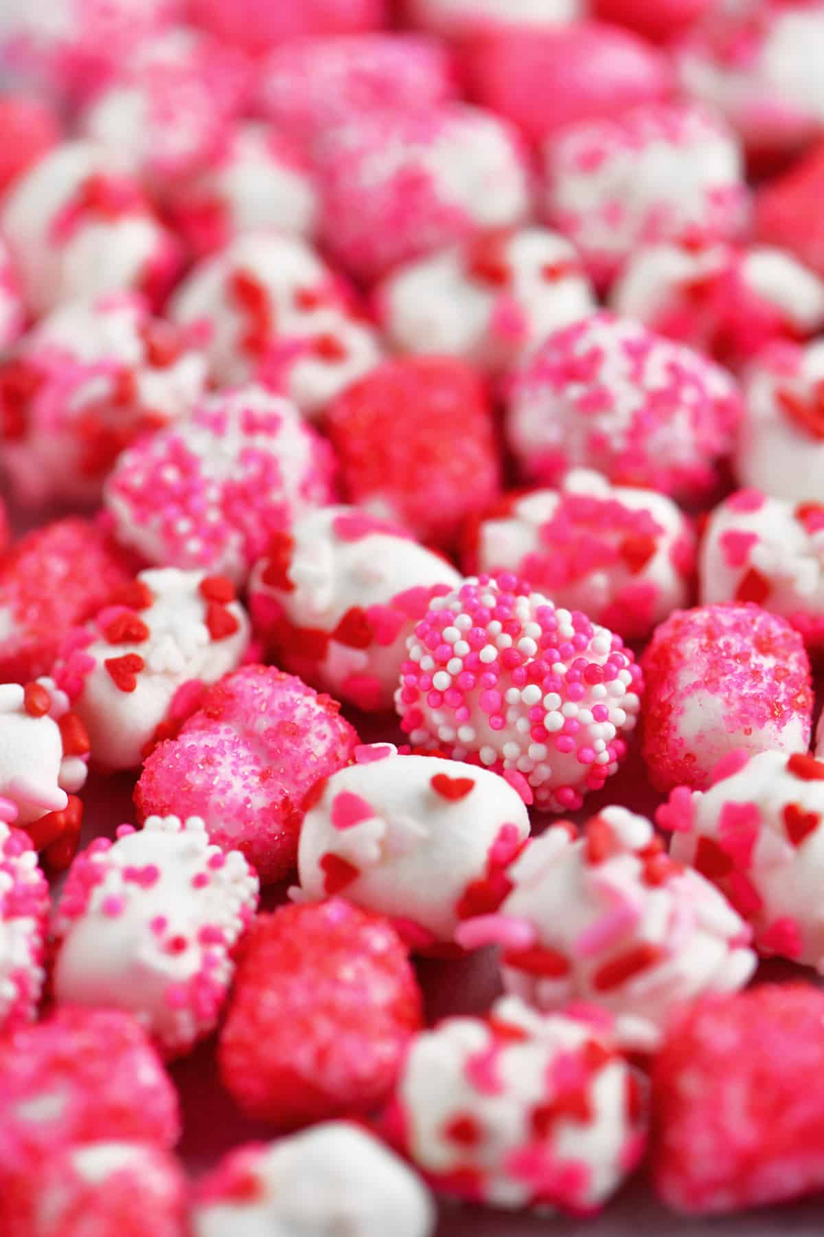 pink, white and red sprinkles on mini marshmallows