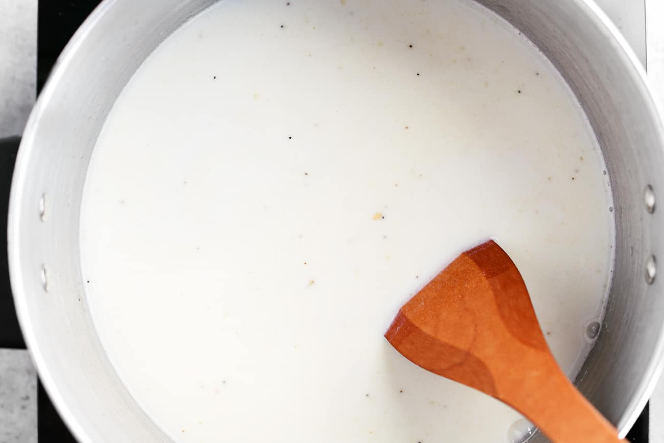 milk, water and soup ingredients in a cooking pot