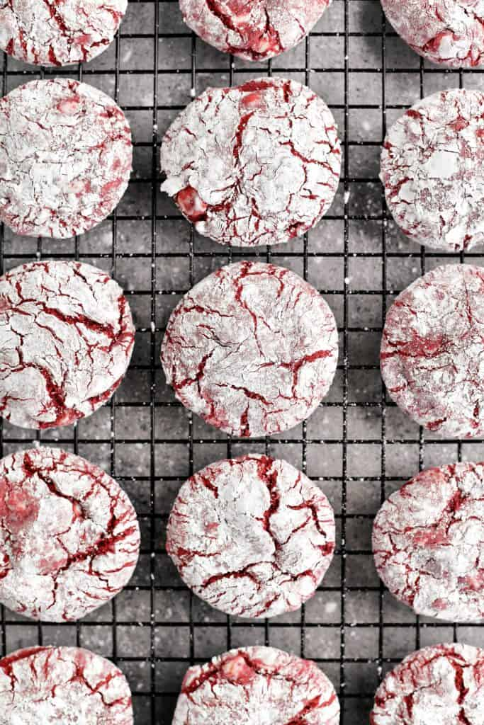 rows of red velvet crinkle cookies on a cooling rack