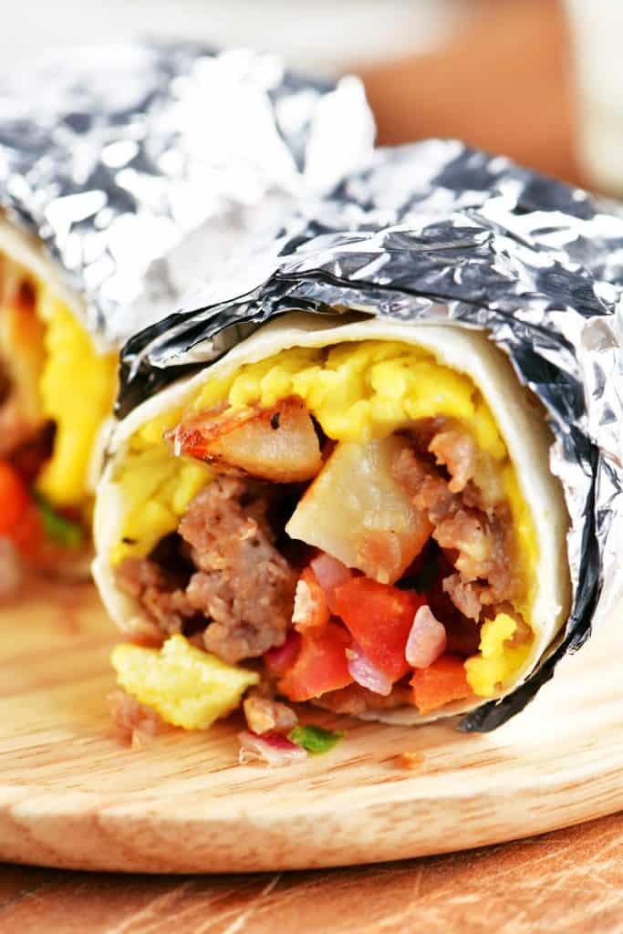 a breakfast burrito wrapped in foil