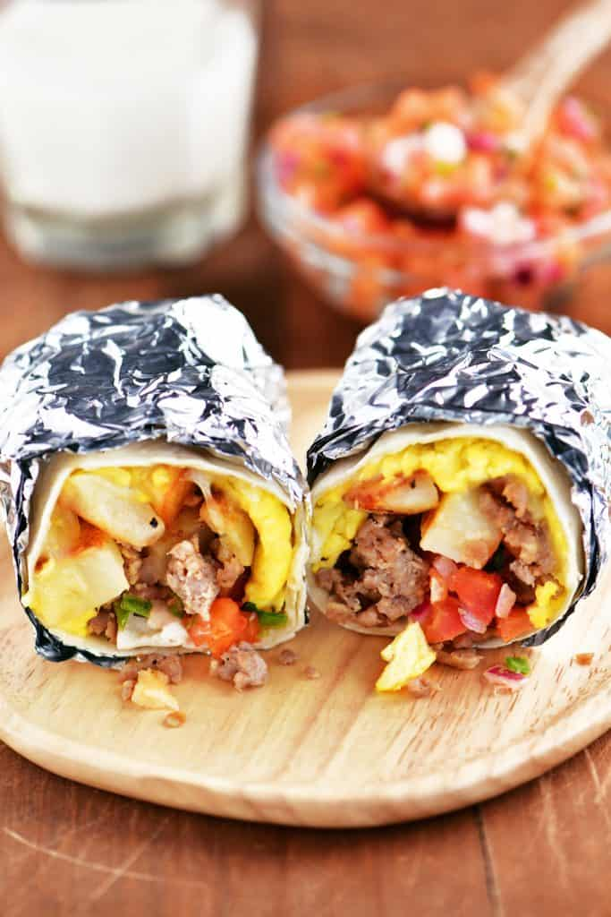 foil wrapped southwest breakfast burritos on a plate