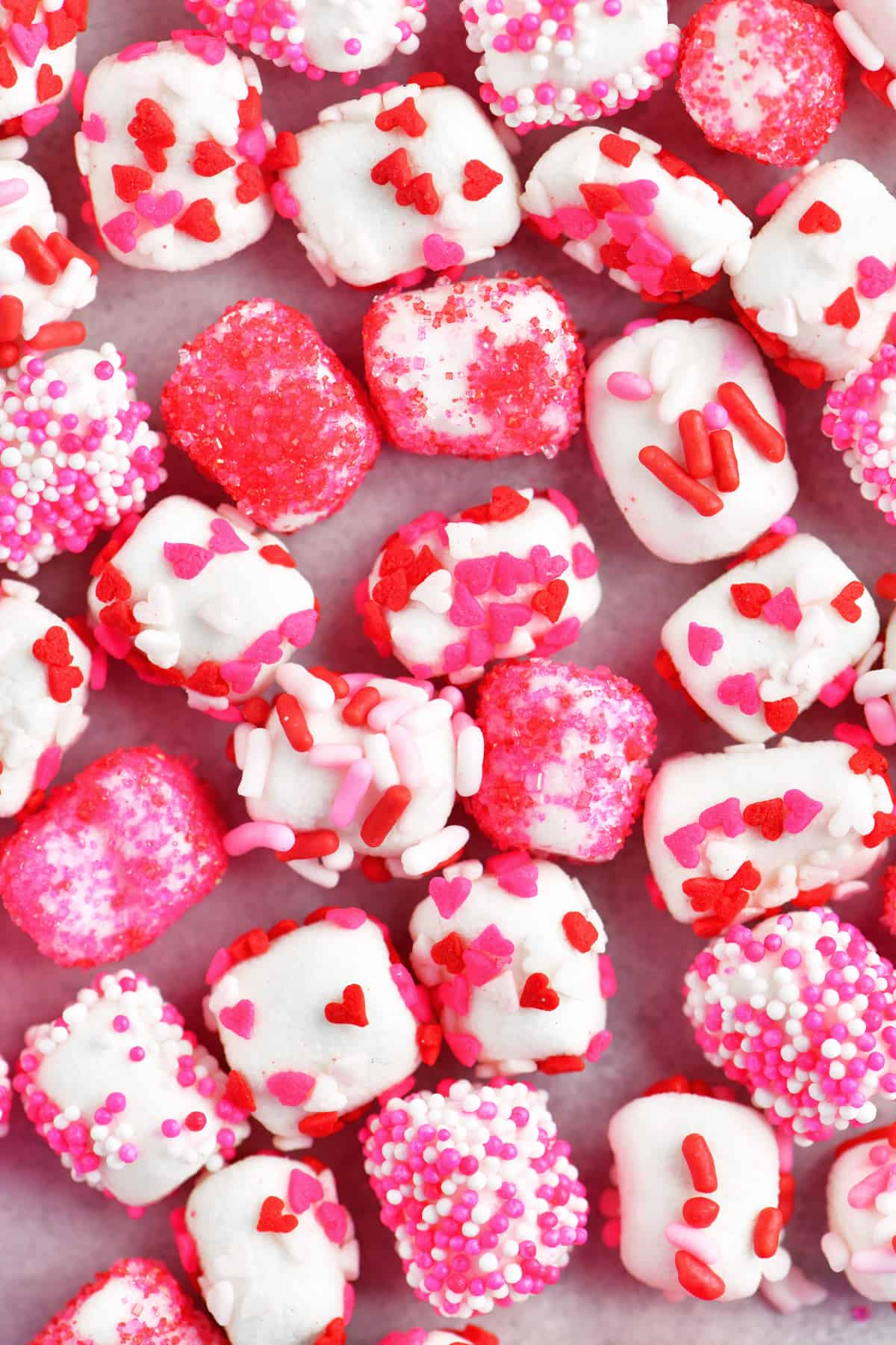 pink and red sprinkles on marshmallows