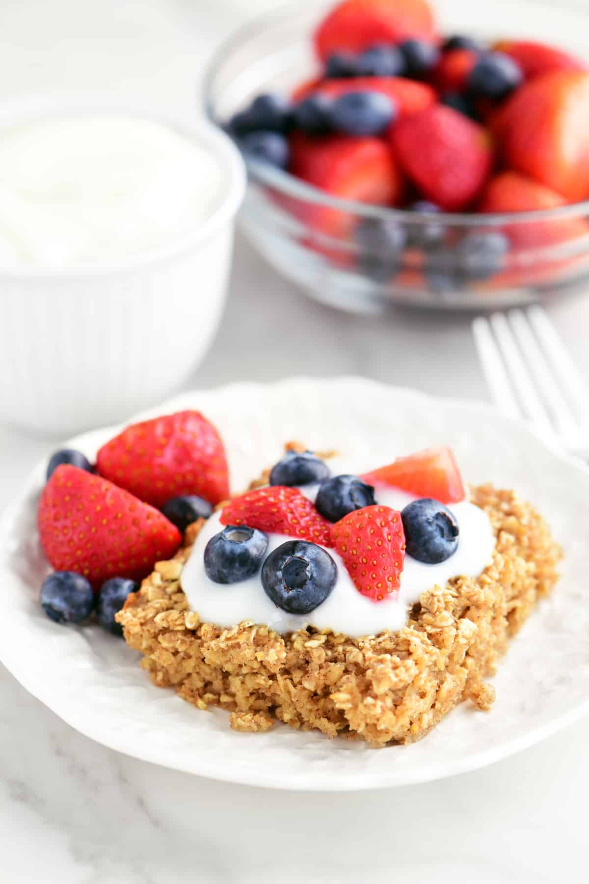 oatmeal and fruit breakfast food on a plate