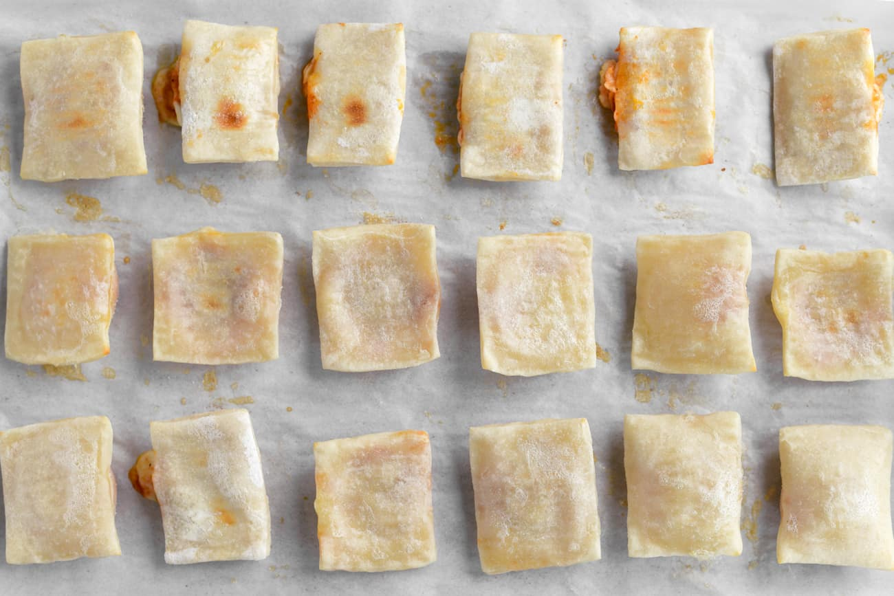 baked two ingredient dough pizza rolls in rows