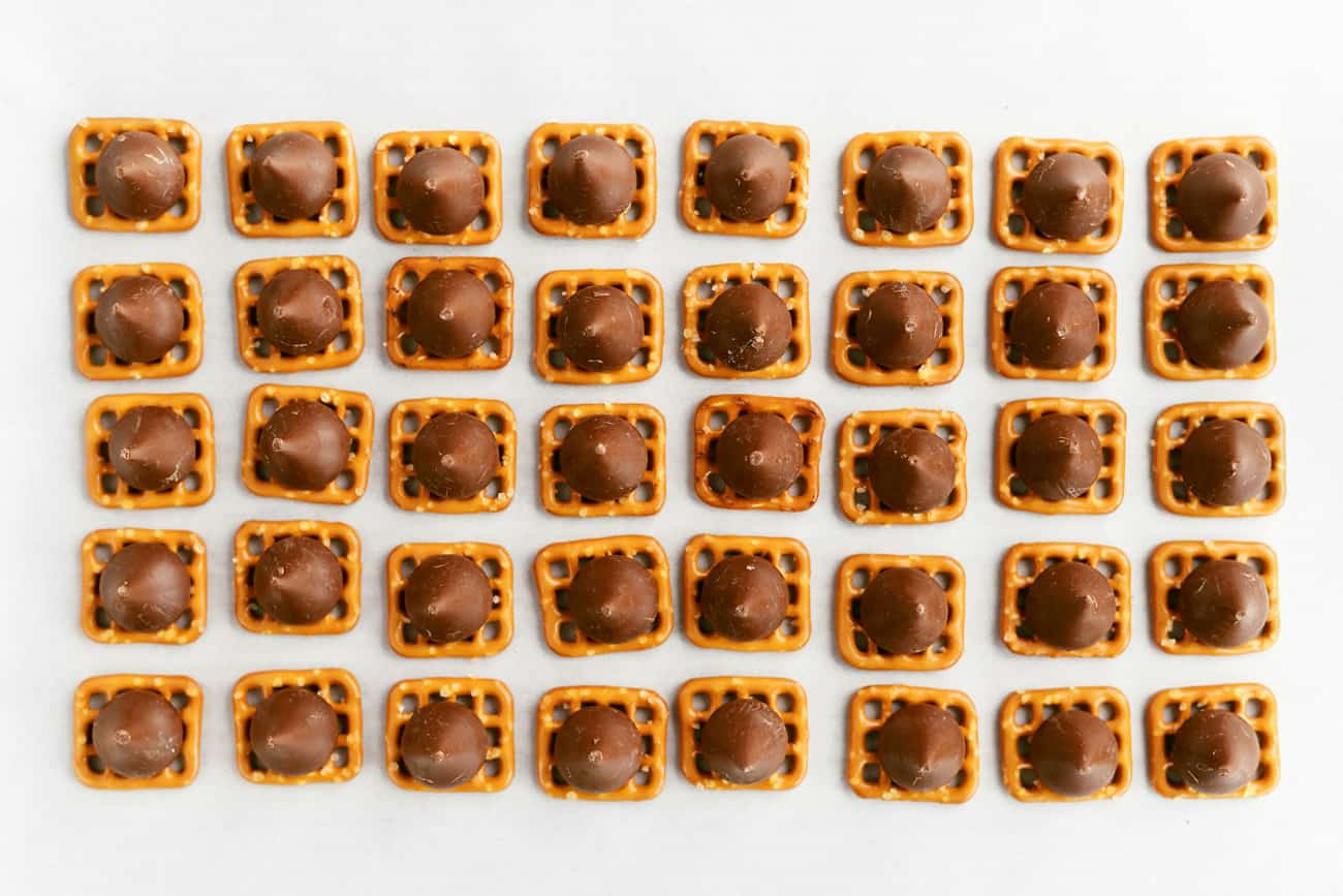 40 pretzel squares with Hershey kisses on top