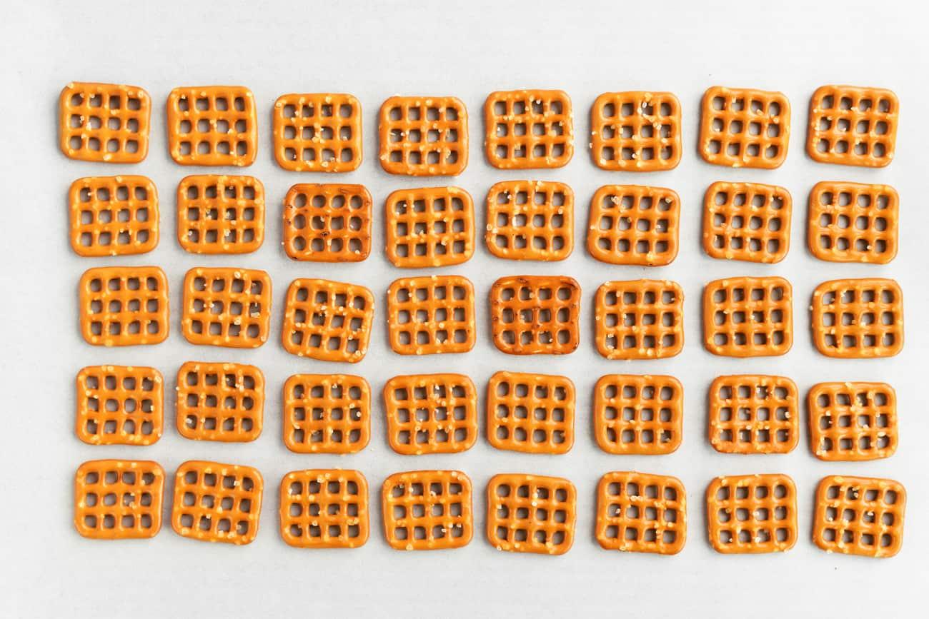 pretzel squares on a sheet of parchment
