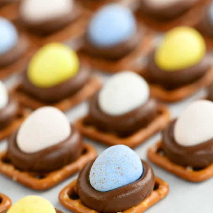speckled candy eggs on chocolate kisses which are on pretzels