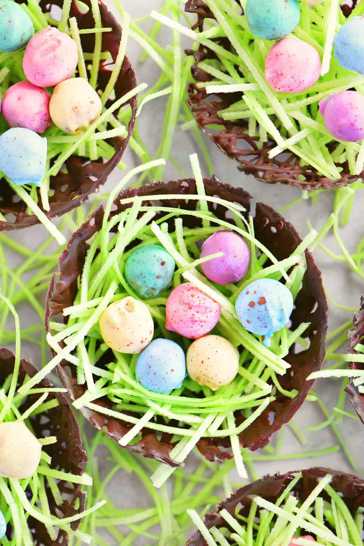 bright, cheery pretzel nugget eggs in a chocolate nest