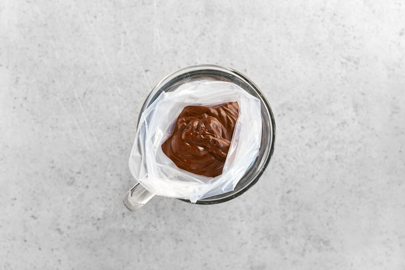 melted chocolate in a plastic cake decorating bag