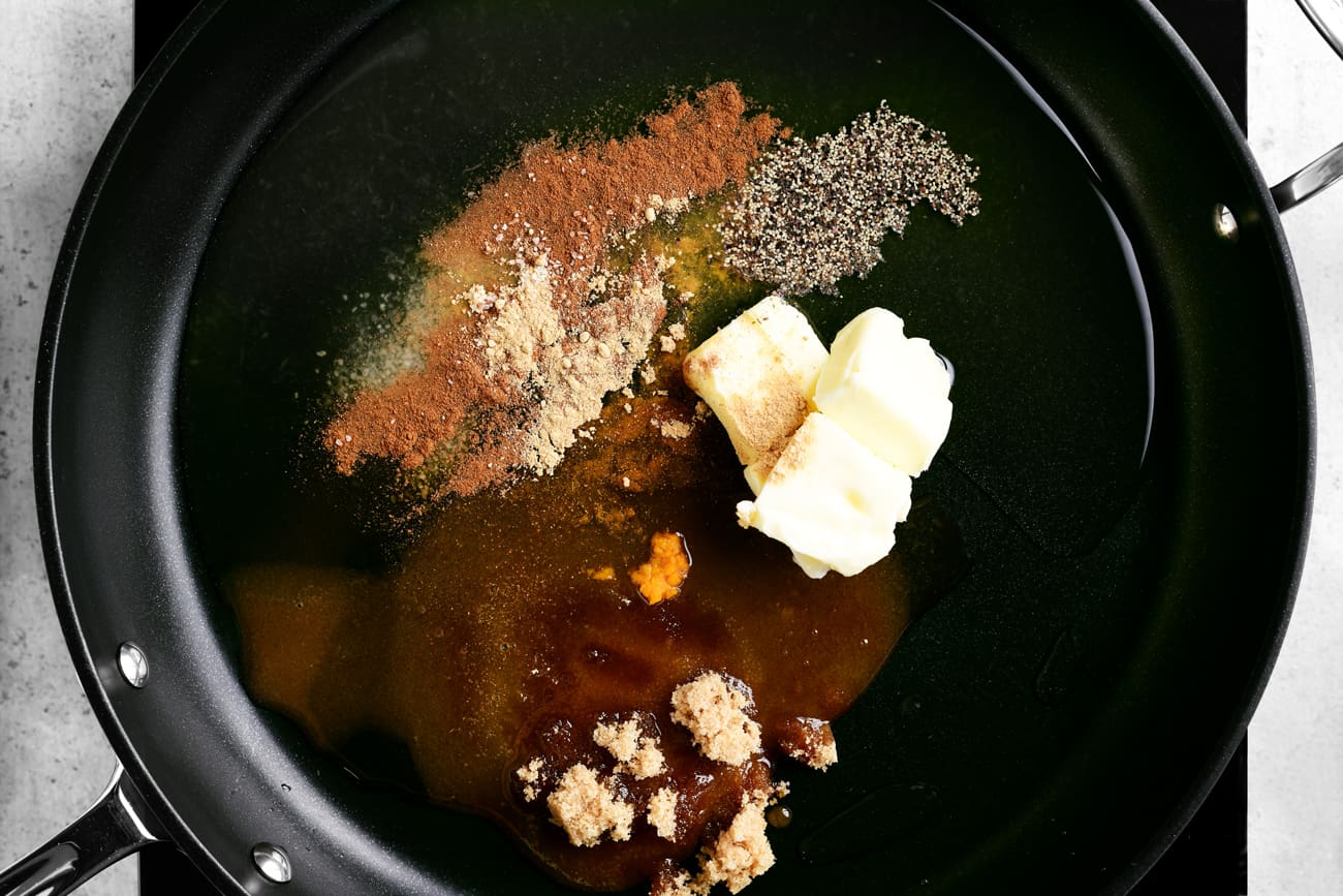 butter, brown sugar, and other spices in a frying pan