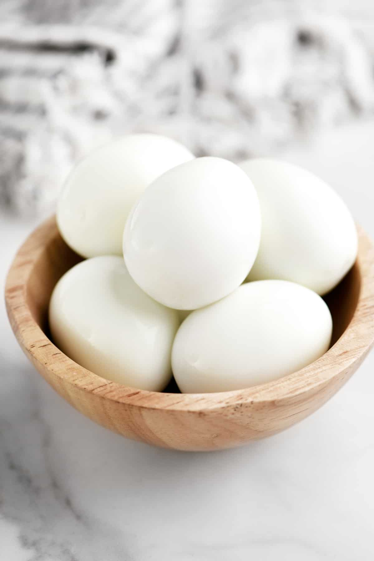 hard cooked eggs in a wooden bowl