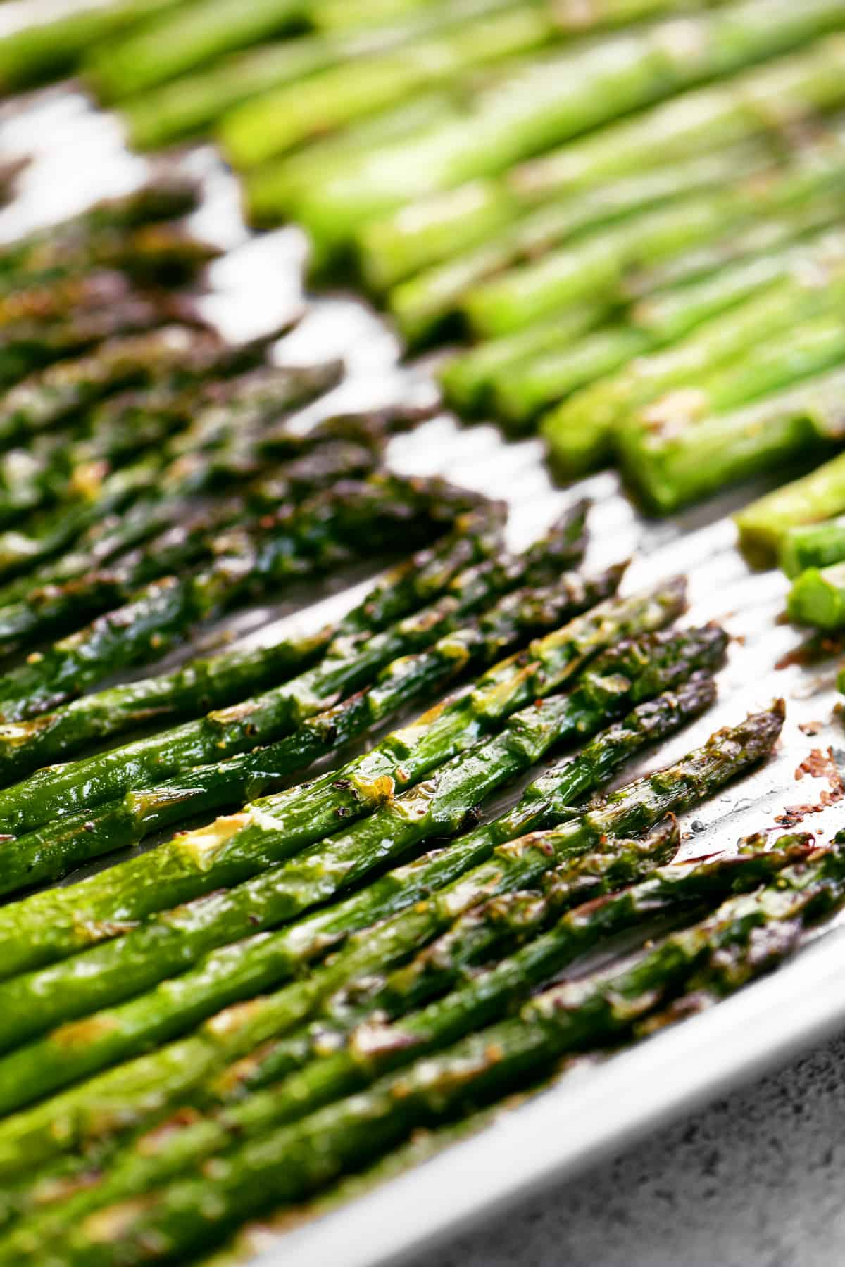 cooked asparagus on a metal pan