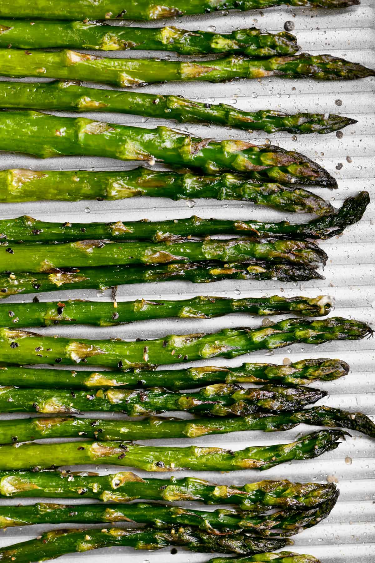 asparagus lined up on a pan