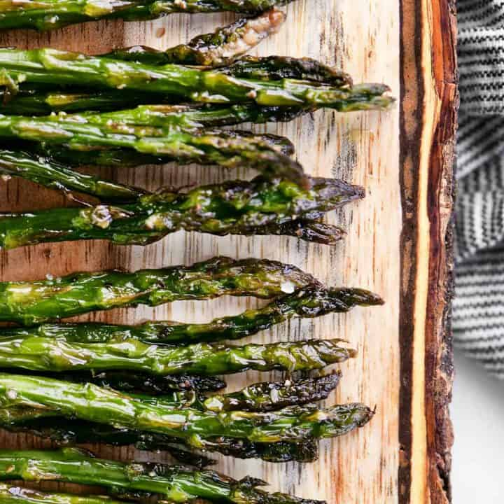 roasted asparagus on a wood cutting board