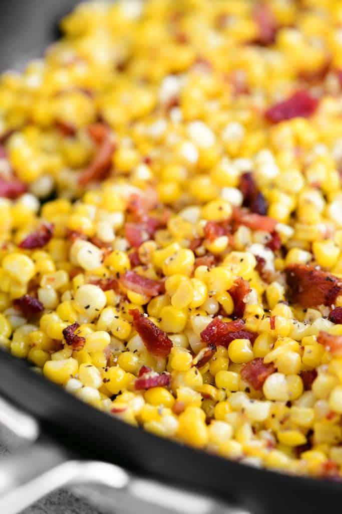 a close-up photo of the bacon and corn in the pan