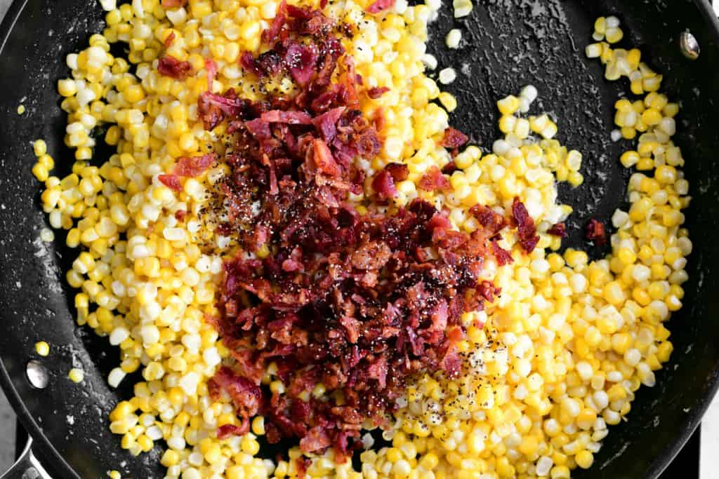 bacon, pepper and corn in a pan