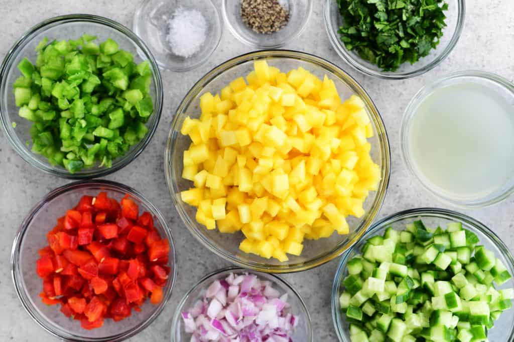 chopped veggies and fruit in small bowls