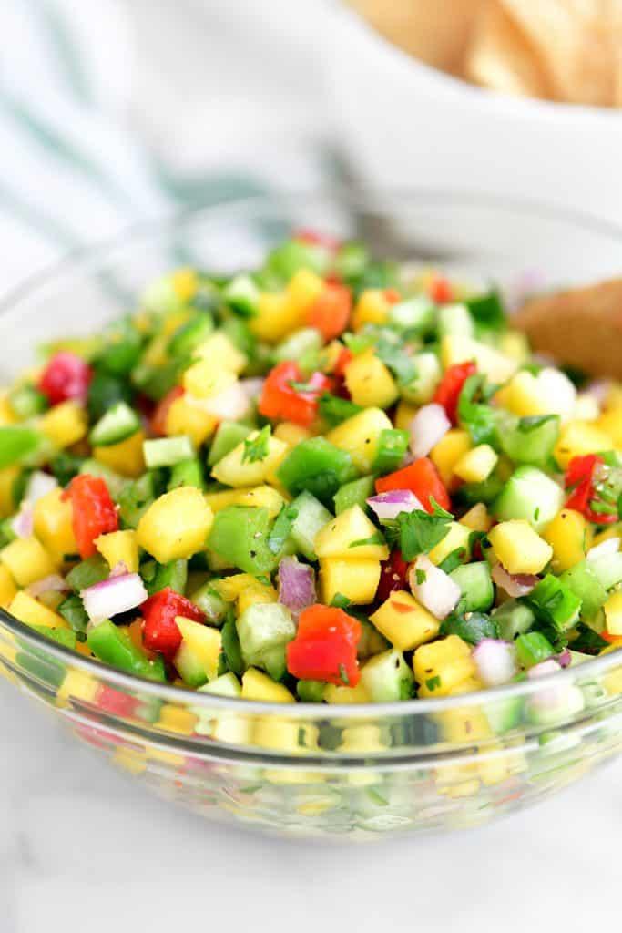 mango salsa in a clear glass bowl