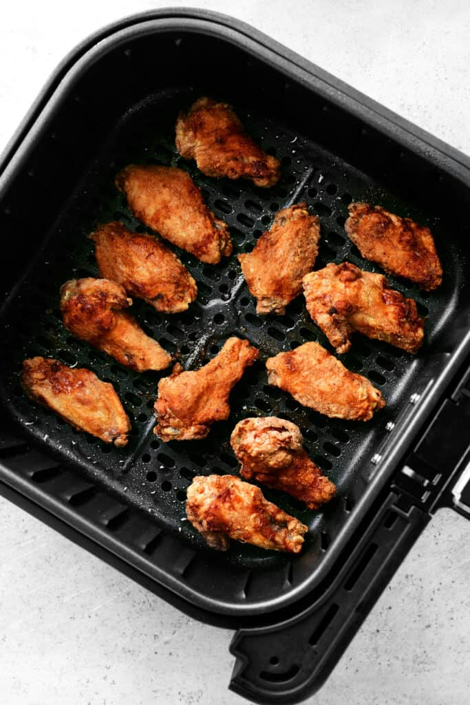 fried chicken wings in the air fryer basket