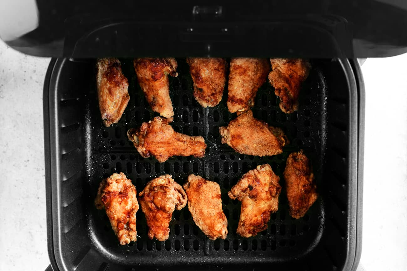 cooked chicken wings in the fryer basket