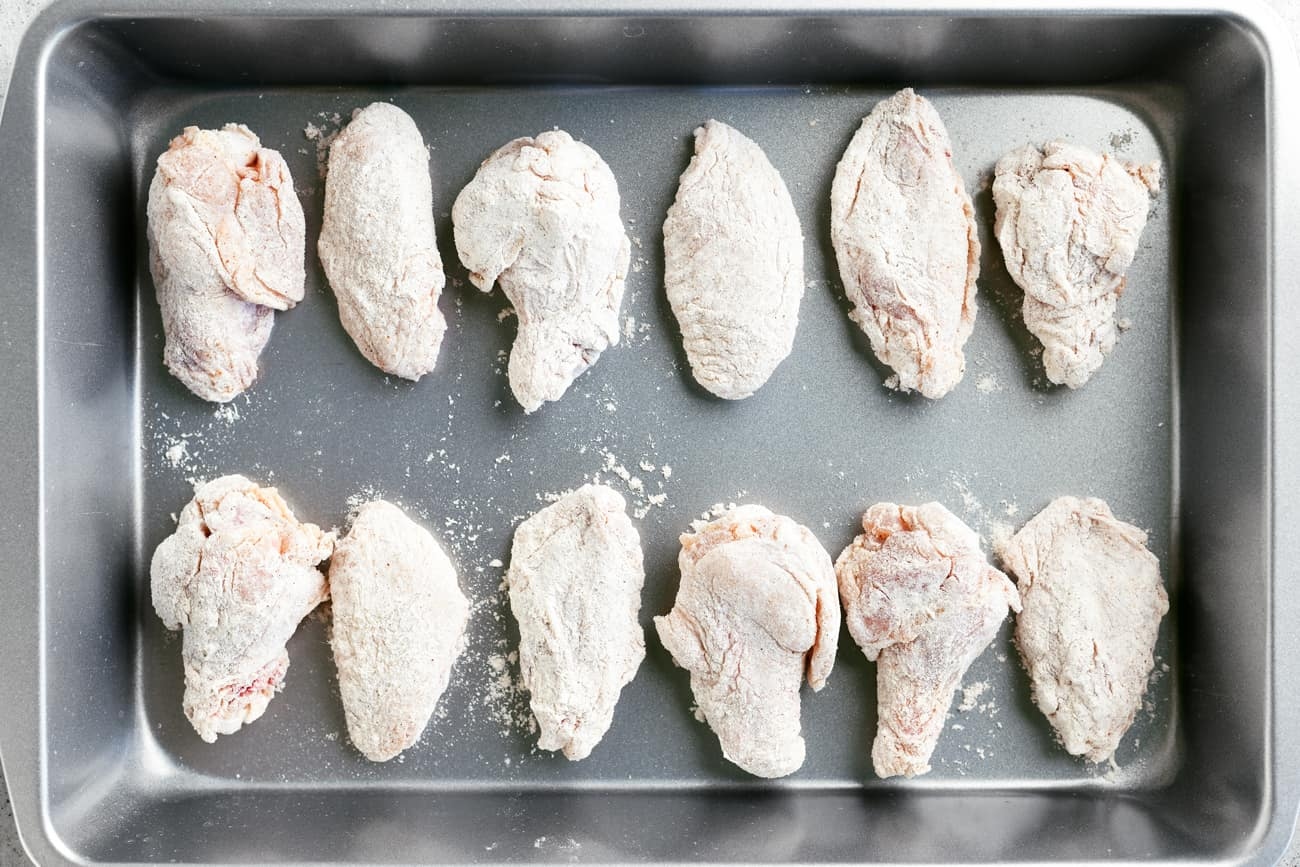 coated chicken wings in a pan