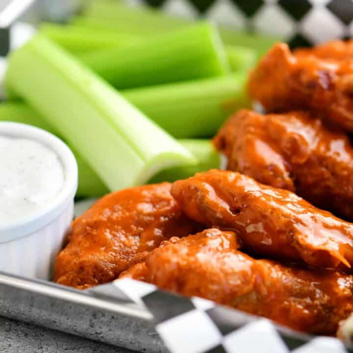buffalo chicken wings with celery on a tray
