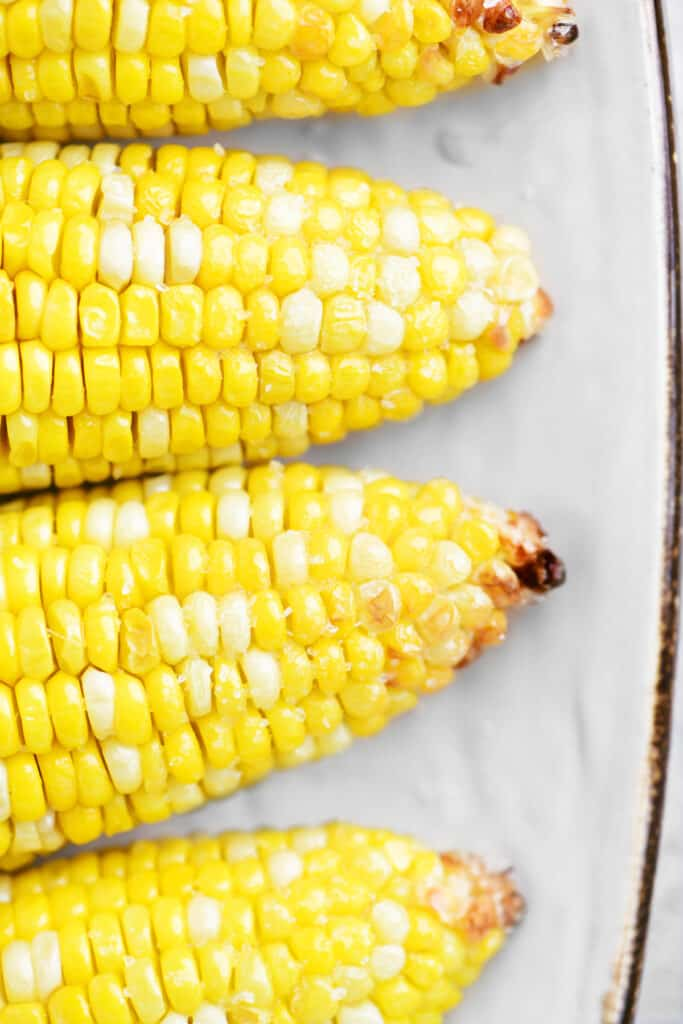 close up of air fryer corn on the cob