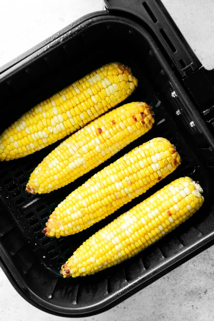 air fryer corn on the cob in the fryer basket