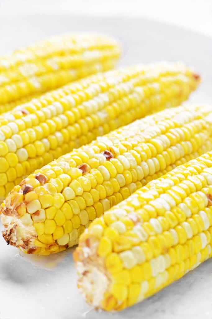 sweet corn on a white platter