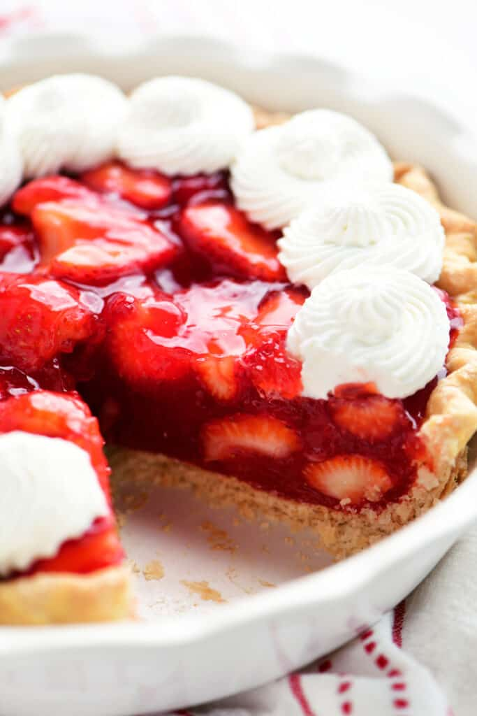 a strawberry pie with a piece cut out
