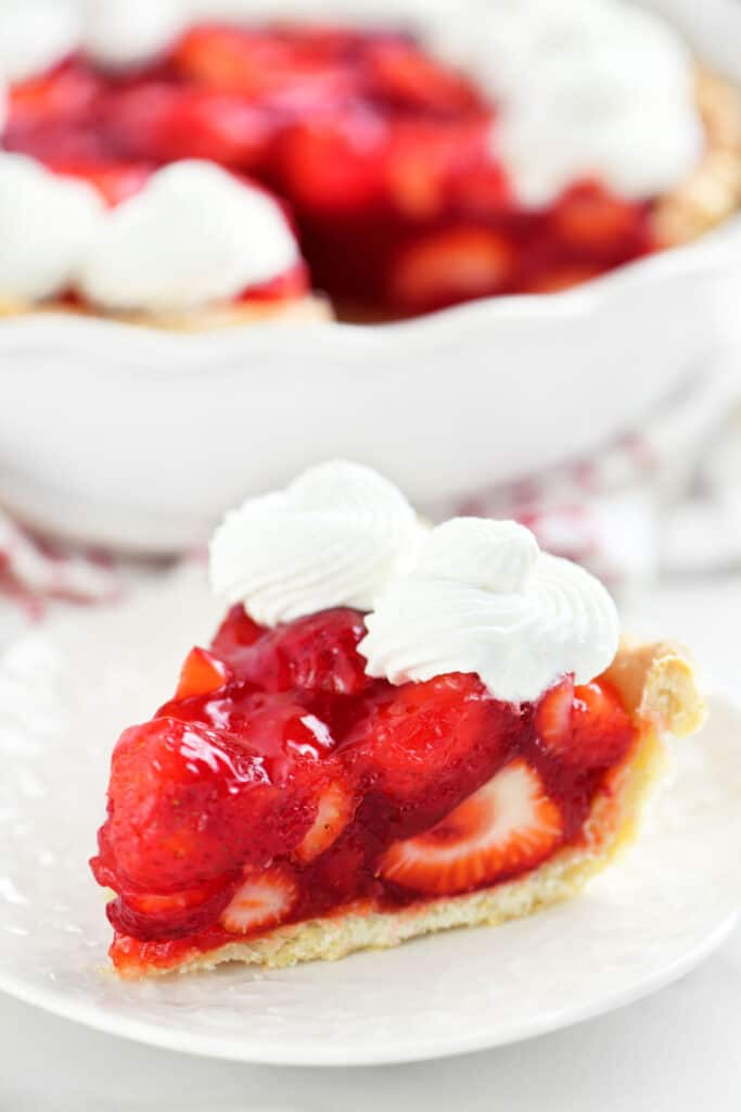 a slice of strawberry pie on a small white plate