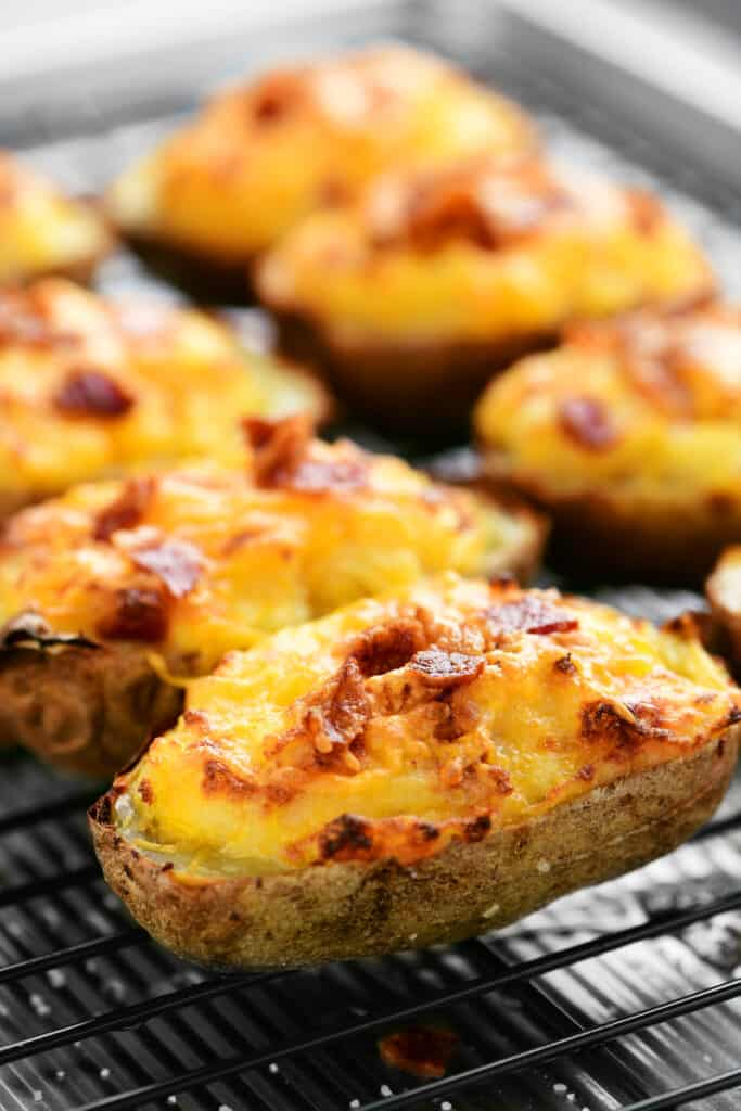 several twice baked potatoes on a wire rack
