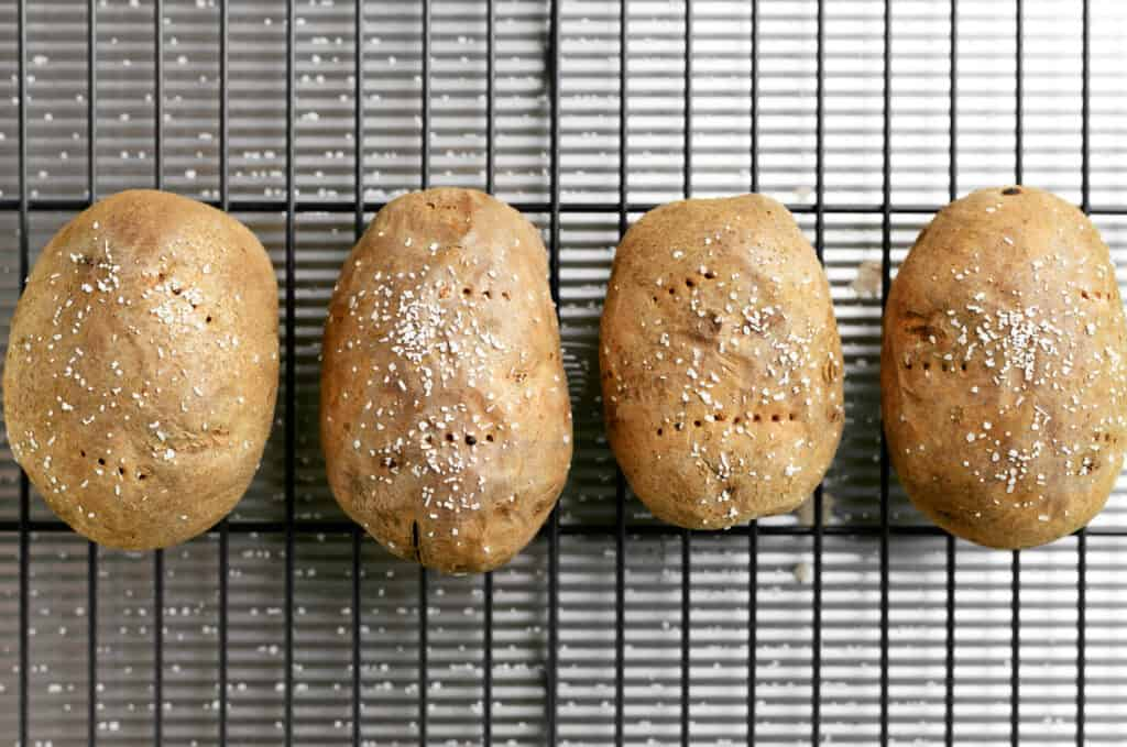 four spuds on a wire rack