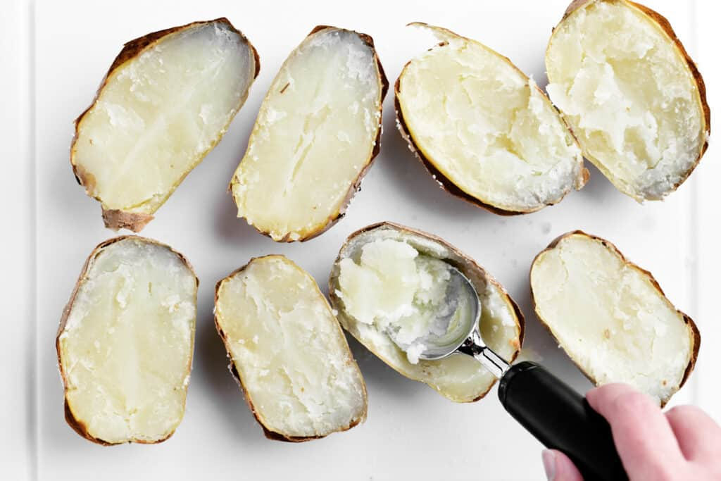use an ice cream scoop to remove insides leaving skin intact
