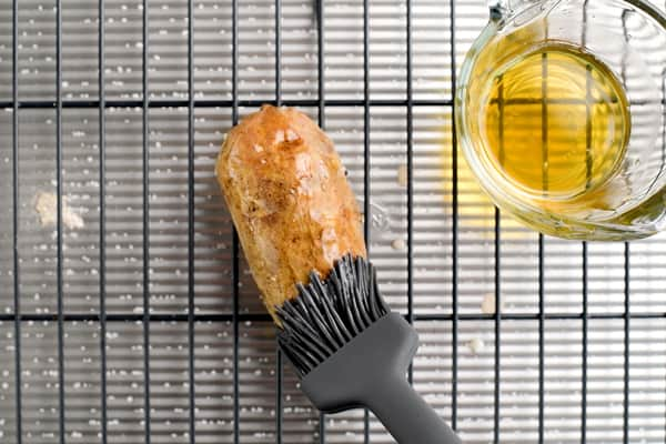 brushing potato skin with bacon grease