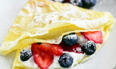 berry filled crepe on a plate