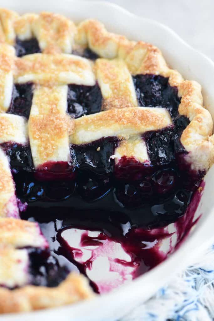 the blueberry pie with a piece removed from the serving dish