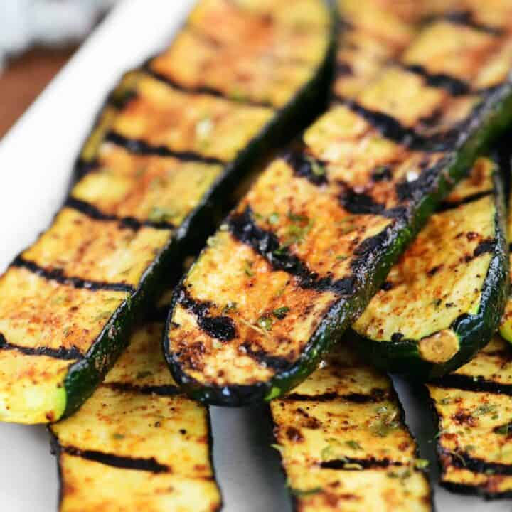 several pieces of grilled zucchini on a platter