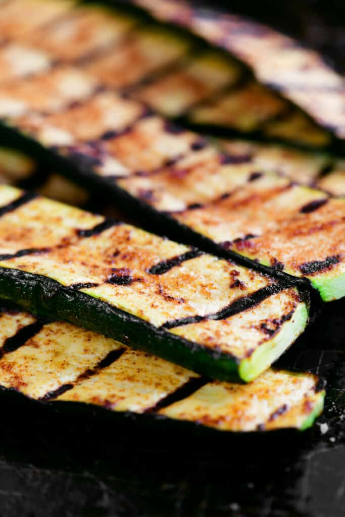 grilled zucchini slices in a pile