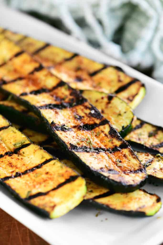 a small stack of grilled zucchini on a platter