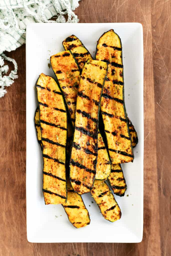 a platter of grilled zucchini