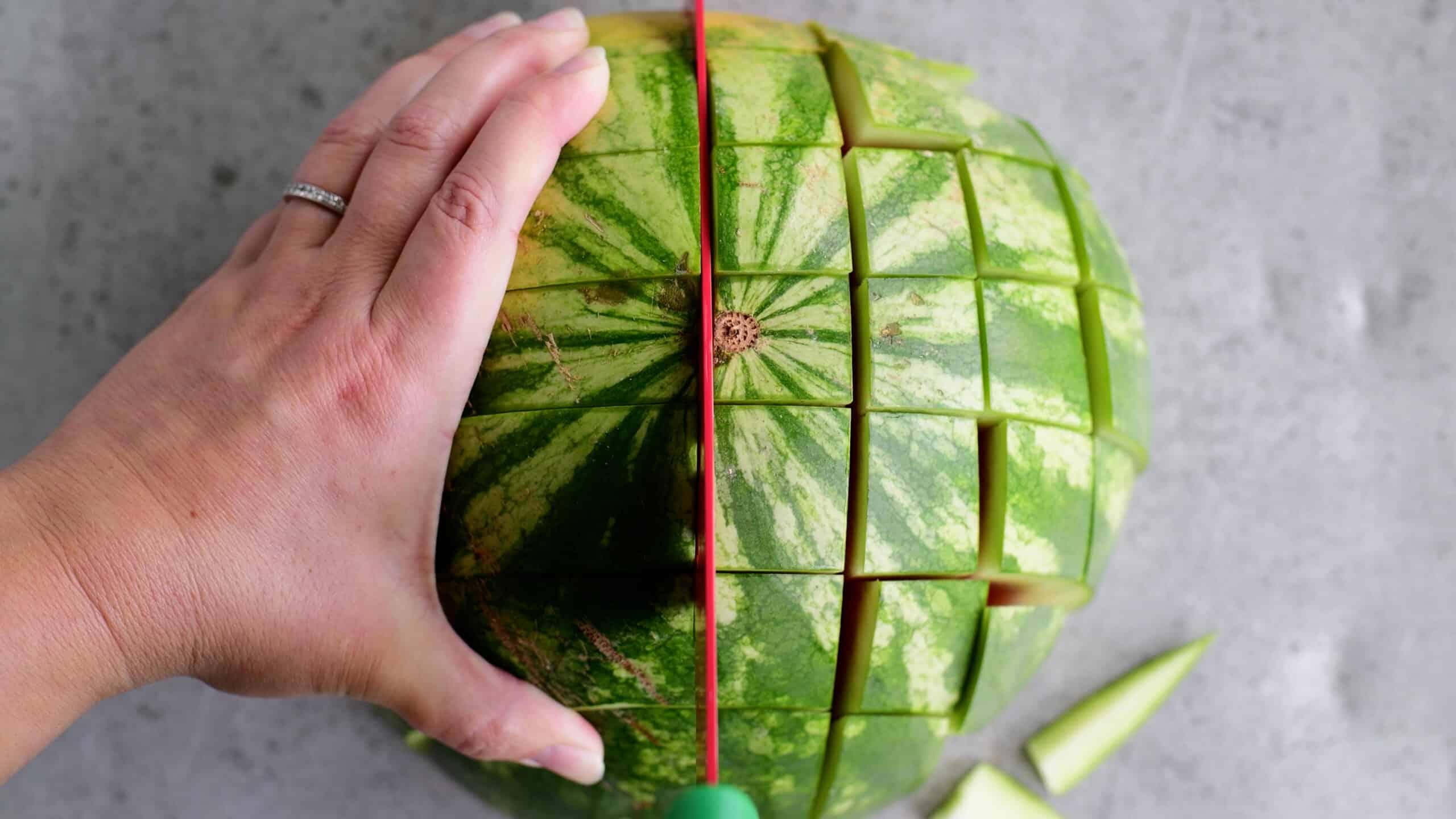 cutting a watermelon into sticks