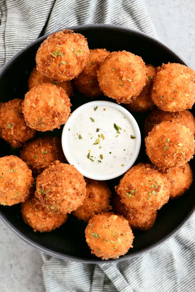 corn poppers on a tray with dip