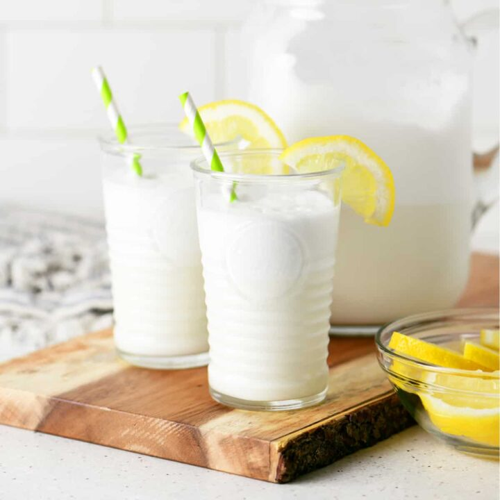 creamy lemonade whip in two glasses with lemon slices and straws